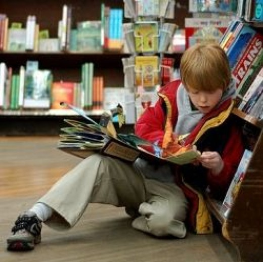 Child reading at Brookline Booksmith