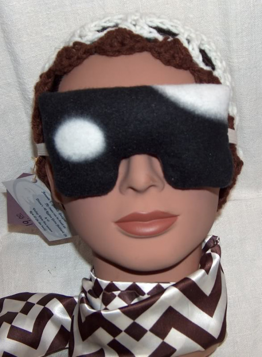 An eye mask pillow or sleep pillow with real lavender buds inside.  All sewn by hand.