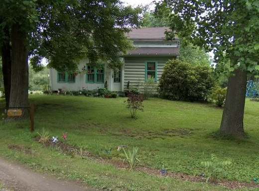 Photo of the old house and homestead