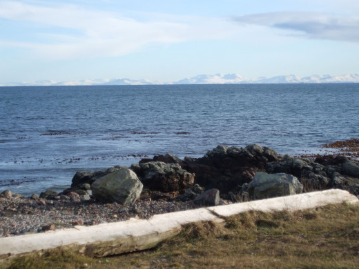 Picture Credit: Author's own photograph. Looking across the water from 'our' beach. You can see the snow covered mountains of Sutherland (North West Scottish Mainland) on the horizon.