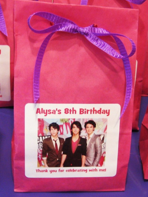 The complete favor bag for the Jonas Brothers party using a the lunch style bag with personalized label.