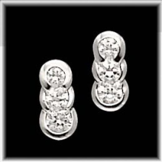 14kt. White Gold Past, Present, & Future Moissanite Earrings