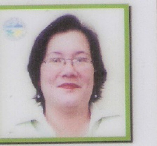 Liza  or CLARIZA RADOMES GARCIA  Asst. Mun. Civil Registrar at 46 years old
