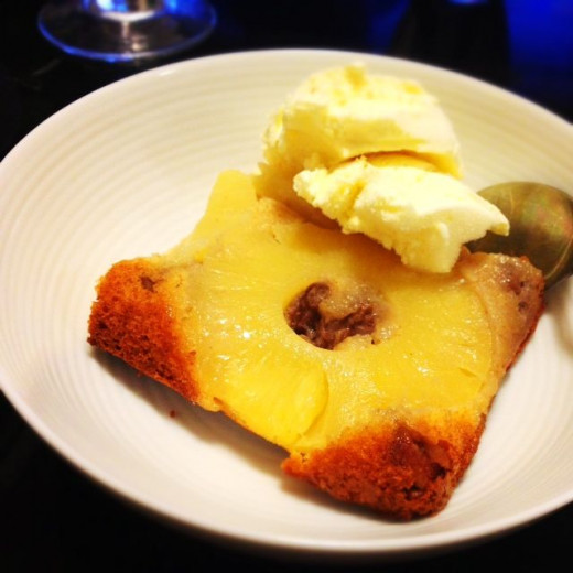 Here's a slice with some vanilla ice cream. A perfect ending to a meal.