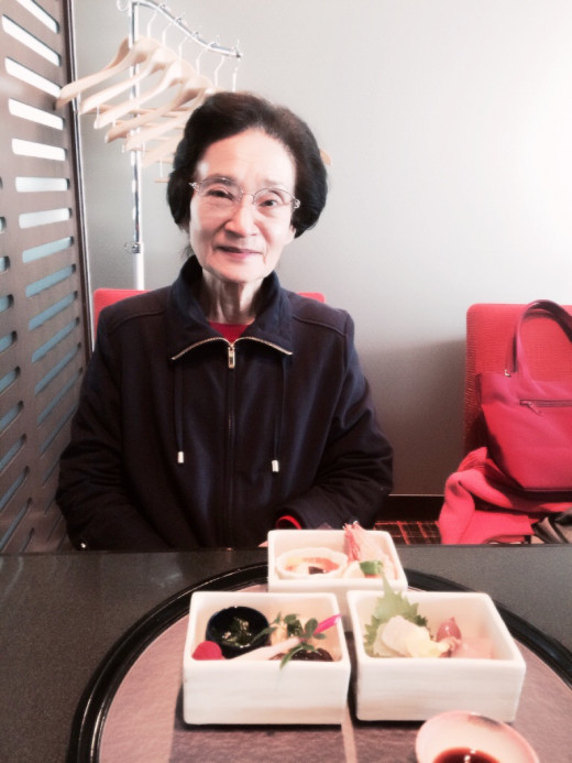 My mother and her lunch of Japanese delicacies.