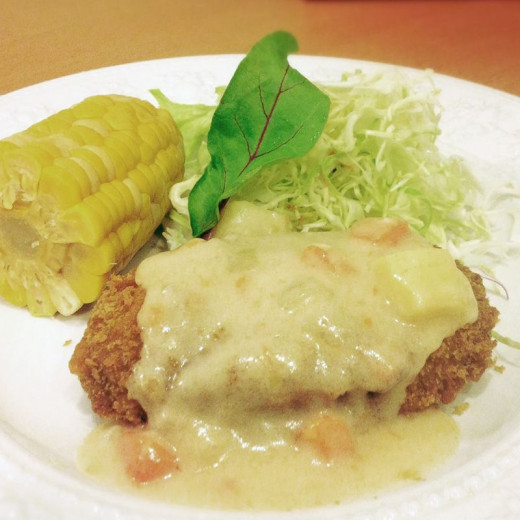 Japanese croquettes with cream sauce.
