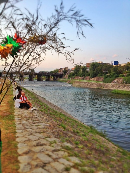 Sit and gaze at the gentle waters of Kamo River.