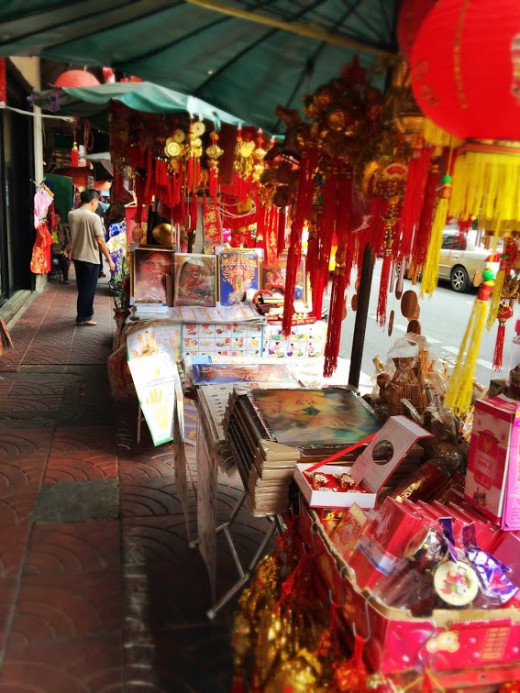 Chinese trinkets, lottery tickets and traditional herbal shops line the streets.