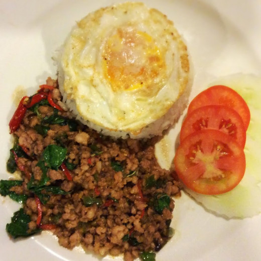 Gai Pad Gaprao, spicy ground meat stir-fried with Thai basil and chilis with rice and fried egg. One of my favorite Thai dishes.