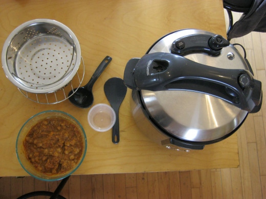 My Breville Slow-Fast Cooker with utensils and my chickpea and sweet potato curry lunch made in it.