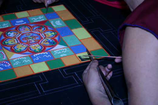 The delicate work of creating a sand mandala