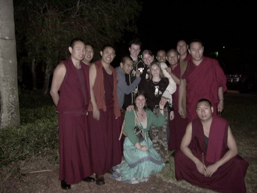 Three of my children and me with the monks. Alex, Alesia & Aria. Aria is wearing elf ears which the monks found very funny!