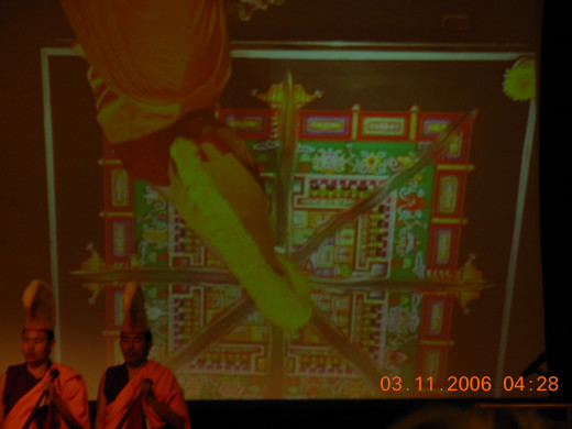 Destroying the mandala as viewed on the jumbo screen