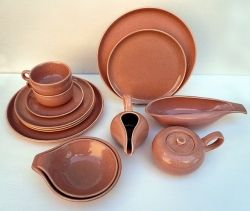 JoeVintage.etsy.com shows an American Modern 14 pc Coral Set (Vintage) For $115