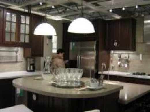 Large kitchen island with pendant lights overhead