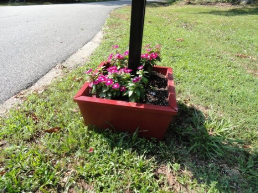 Base that fits around existing mailbox. Where to get: http://www.etsy.com/listing/103568541/base-mailbox-planter