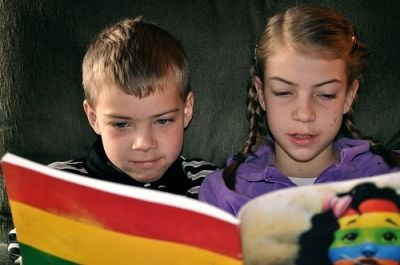 Children Delighted by a Book