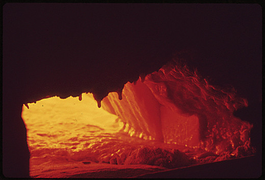 2500 degrees F. furnace where crushed bottles are made into molten glass.