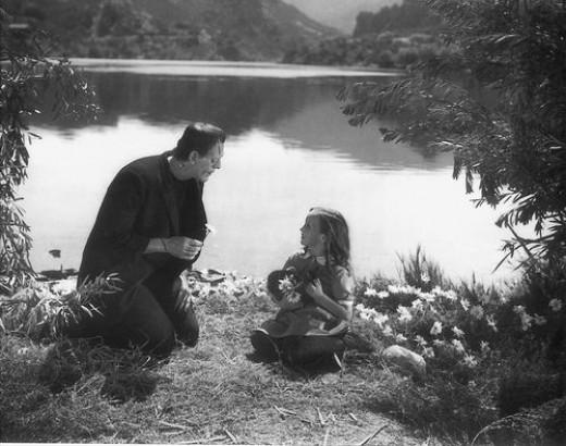 Frankenstein innocently befriending a little girl. Boris Karloff as the Frankenstein Monster, Marilyn Harris (1924-1999) as Little Maria, 1931