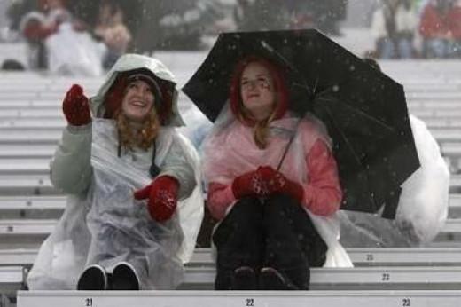 """Fans watch snowboarders - """"It's raining.  Soooo?"""""""