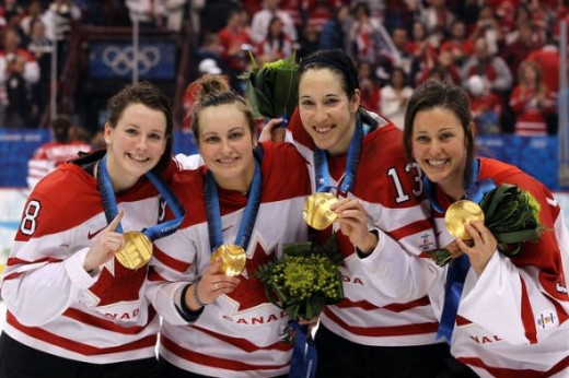 Hockey Team Canada receive 2 Gold medals & celebrate their two victories