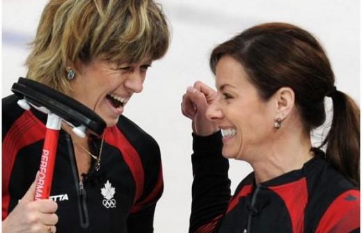 Canada's Cori Bartel celebrates with skip Cheryl Bernard a curling victory.