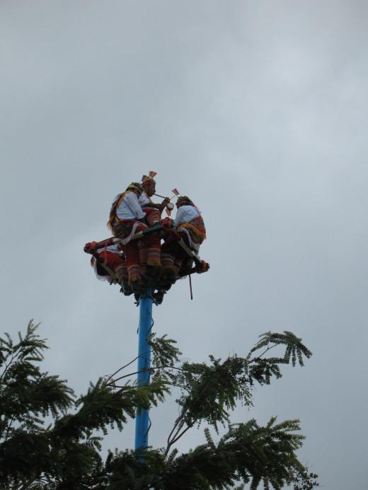 Papantla flyers performing outside the ruins