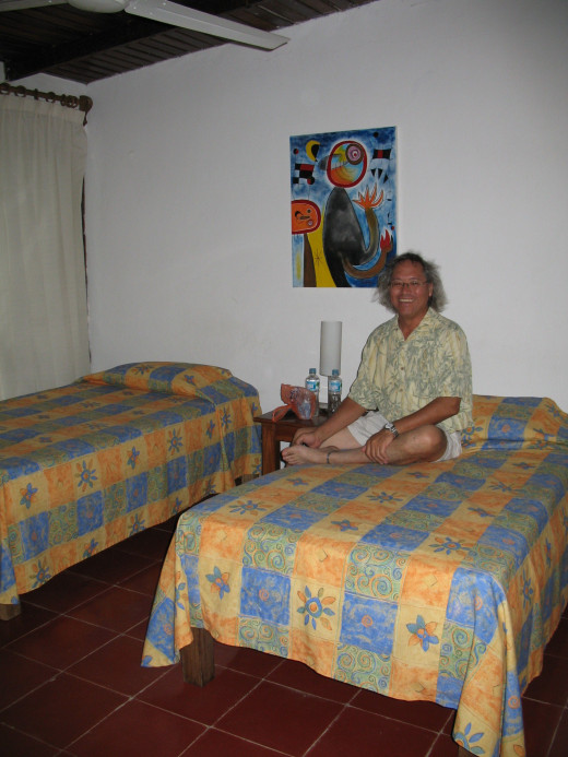 Alejandro relaxing in our comfortable room. The community kitchen was on the same floor.