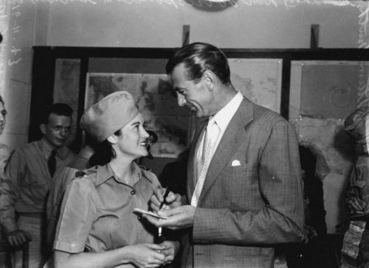 Gary Cooper signing an autograph