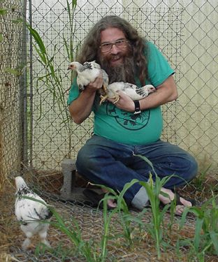 Man with Chickens