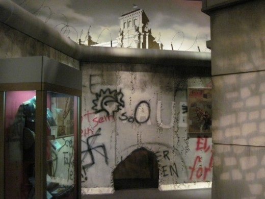 This is part of the reconstruction of a portion of the Berlin Wall within the exhibit area. Around the corner is another hole at the bottom so children could crawl through one hole and come back out through the other. They did.
