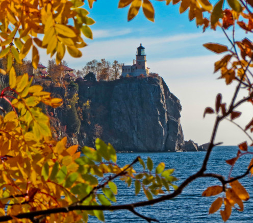 This photo was taken from a nearby campground where I climbed on a rock to get the lighthouse framed in the fall foliage.
