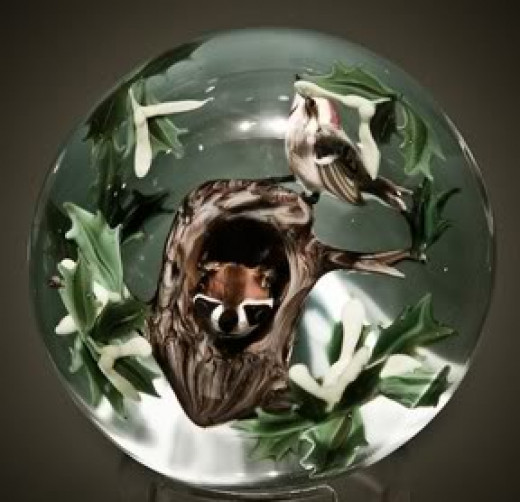 A Raccoon Paperweight by Michael Lee Chin