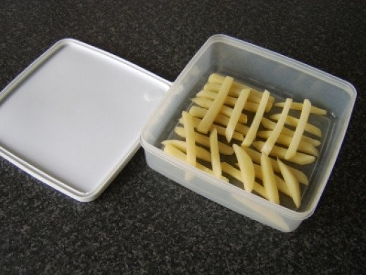 The French Fries are Returned to the Plastic Dish and the Refrigerator