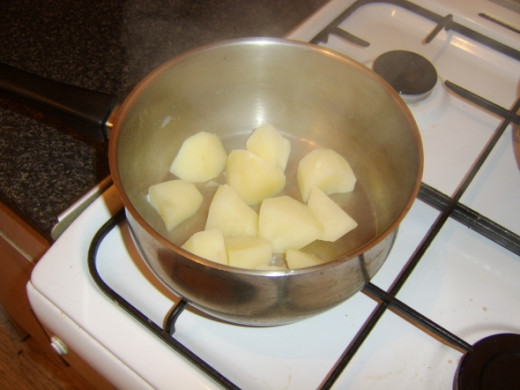Potatoes are drained and left to steam and dry