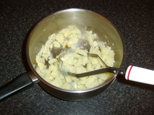 Potatoes are mashed with a little butter