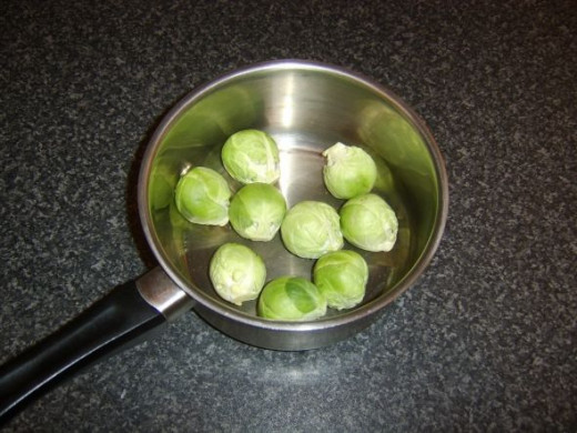 Brussels sprouts are added to a pot with salted, boiling water