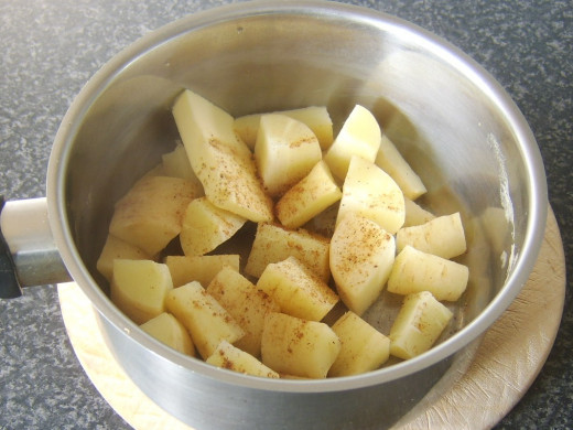 Butter and nutmeg are added to drained parsnips
