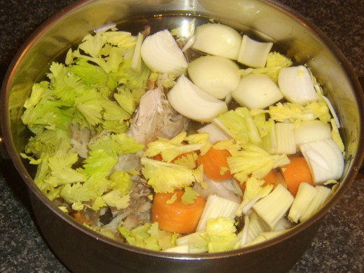 Water is added to comfortably cover turkey bones and vegetables