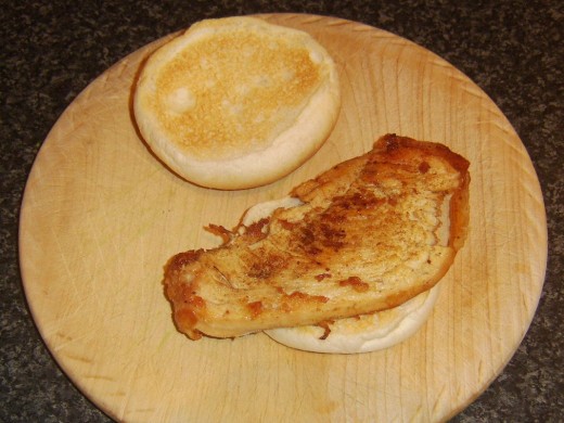 Refried turkey breast is laid on toasted roll
