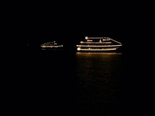 A follow boat joins the Spirit of Seattle Christmas Ship