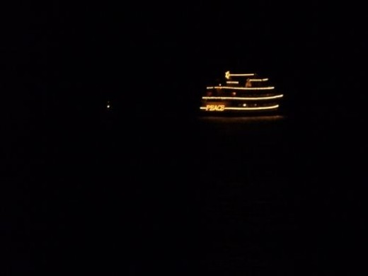 A view of the Spirit of Seattle Christmas Ship departing after the show.  Peace!