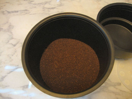 Add the grounds according to instructions. We use 12 ounces of coffee for 6 cups of water.