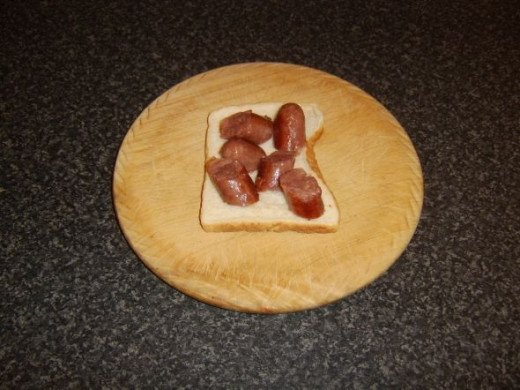 Sausages are first to be placed on bread