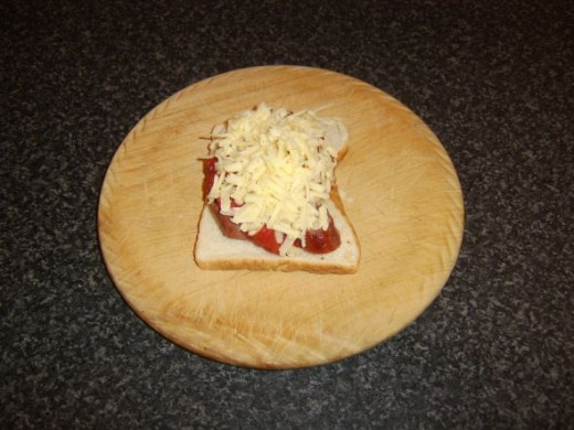 Cheese is scattered over tomato sauce