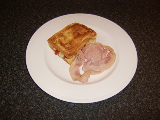 Toastie and bacon are plated