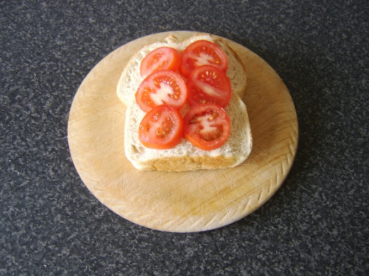 Tomato slices are laid on the untoasted side of the bread