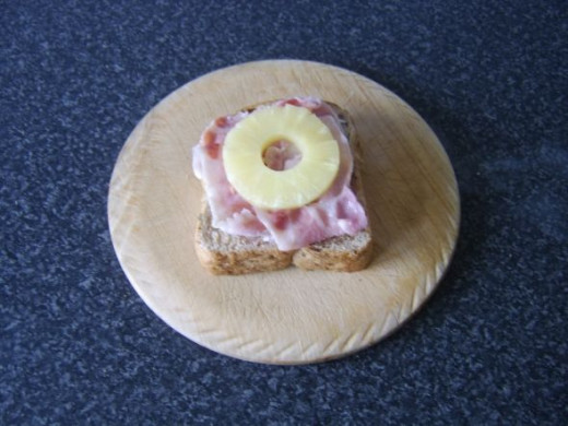 Bacon and pineapple are laid on granary bread