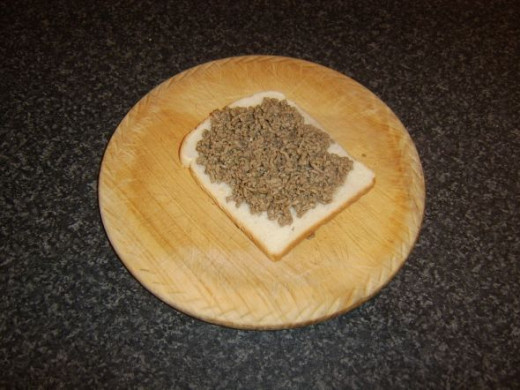 Beef is spread on untoasted side of bread