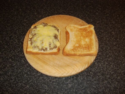 Cheese is melted on beef